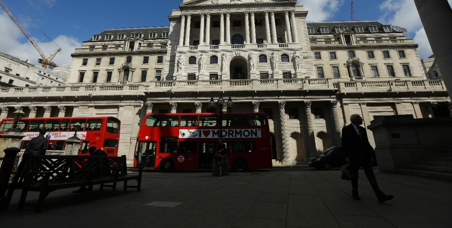 Buses pass the Bank of England, in the City of London, Friday, June 24, 2016. Britain's Prime Minister David Cameron announced Friday that he will quit as Prime Minister following a defeat in the referendum which ended with a vote for Britain to leave the European Union. (AP Photo/Matt Dunham)