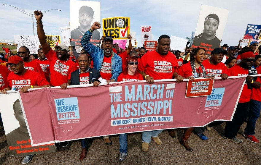 In this March 4, 2017, file photo, thousands march to Nissan Motor Co.'s Canton, Miss., plant, following a pro-union rally.