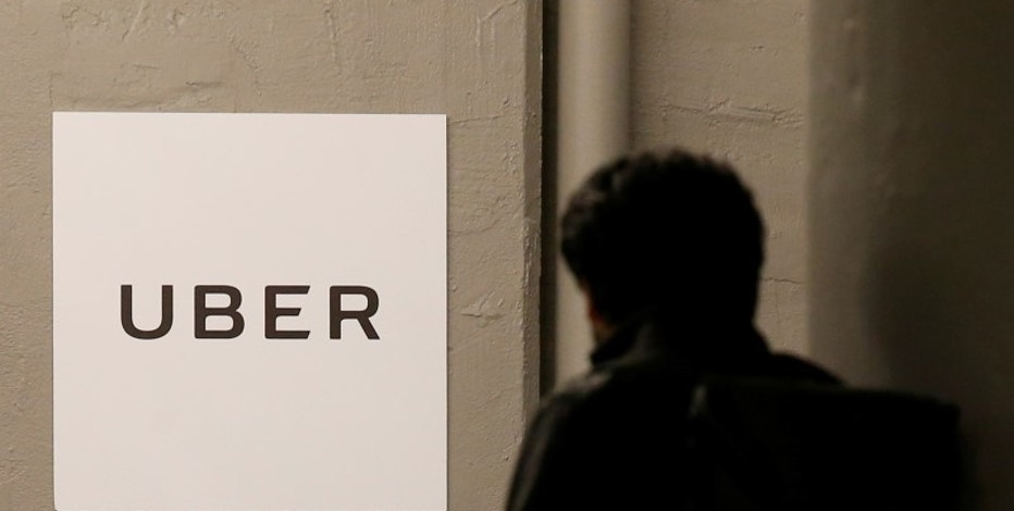 FILE PHOTO: A man arrives at the Uber offices in Queens, New York, U.S., February 2, 2017.  REUTERS/Brendan McDermid
