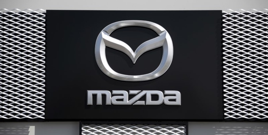 A Mazda car company logo is seen outside an automobile dealership in Nice, France, March 29, 2016.    REUTERS/Eric Gaillard/File Photo