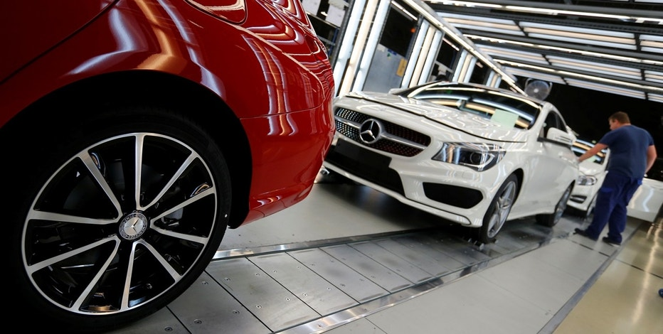 Factory workers inspect cars on the assembly line at Daimler's Mercedes factory in Kecskemet, Hungary, April 29, 2016.