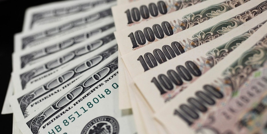 A picture illustration shows U.S. 100 dollar bank notes and Japanese 10,000 yen notes taken in Tokyo August 2, 2011. Japan primed financial markets on Tuesday for currency intervention after the yen tested record highs, signalling it may try to tame the unit with a combination of yen-selling and monetary easing. REUTERS/Yuriko Nakao (JAPAN - Tags: BUSINESS IMAGES OF THE DAY POLITICS) - RTR2PJV0