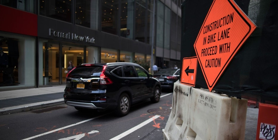Traffic makes it's way past a partially closed 55th street between Park and Madison avenues due to construction, Thursday, Aug. 10, 2017, in New York.
