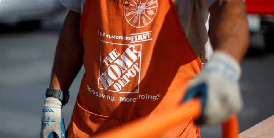 A Home Depot employee is seen outside a store in Los Angeles, California March 17, 2015.