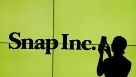 Snap shares rebound from record low in busy day for stock