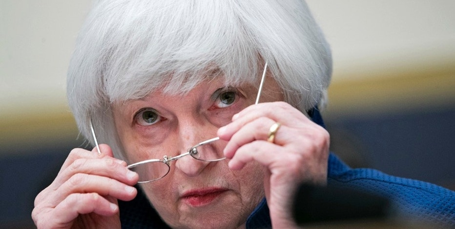 Federal Reserve Chair Janet Yellen removes her glasses as she testifies on Capitol Hill in Washington, Wednesday, July 12, 2017, before the House Financial Services Committee to give the semiannual monetary policy report to the Congress. (AP Photo/Jacquelyn Martin)