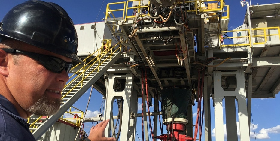 Rig supervisor David Crow shows off the oil rig he manages for Elevation Resources at the Permian Basin drilling site in Andrews County, Texas, U.S. in this photo taken May 16, 2016.