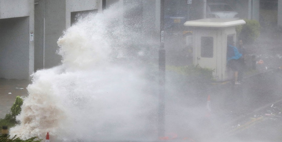 34 injured, flights cancelled as typhoon batters Hong Kong