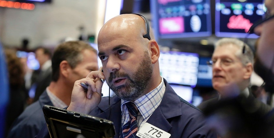 Trader Fred DeMarco works on the floor of the New York Stock Exchange, Wednesday, Aug. 16, 2017. Stocks are opening higher on Wall Street following some encouraging results from retailers. (AP Photo/Richard Drew)