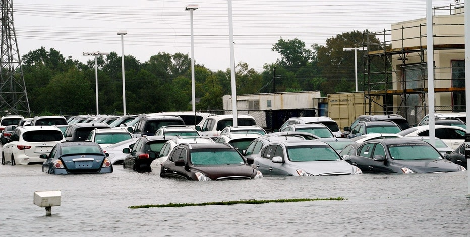 A car dealership is covered by Hurricane Harvey floodwaters near Houston, Texas August 29, 2017.