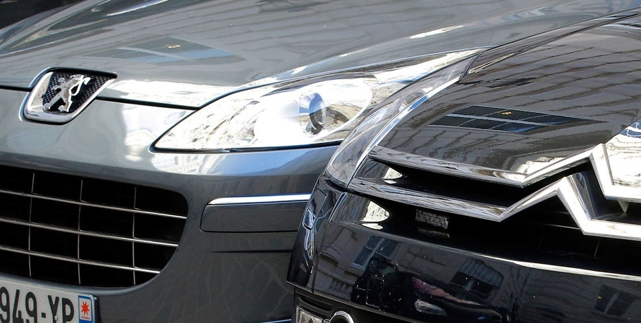 In this Sept. 7, 2012 file photo, a Peugeot, left, and Citroen cars are parked in Paris.