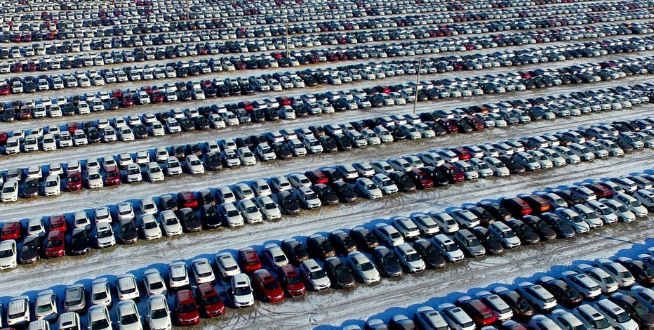 New cars are seen at a parking lot in Shenyang, Liaoning province, China, January 16, 2017.