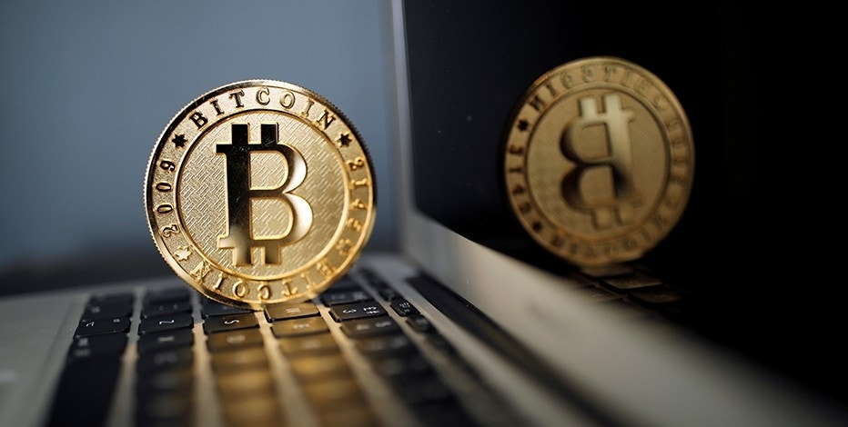 A Bitcoin (virtual currency) coin is seen in an illustration picture taken at La Maison du Bitcoin in Paris, France, June 23, 2017. REUTERS/Benoit Tessier/Illustration - RTS18BSL