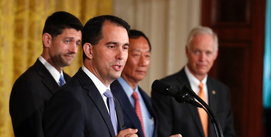 Wisconsin Gov. Scott Walker speaks in the East Room accompanied by House Speaker Paul Ryan of Wis., Foxconn CEO and founder Terry Gou, and Sen. Ron Johnson, R-Wis., at the White House in Washington. (AP Photo/Carolyn Kaster)