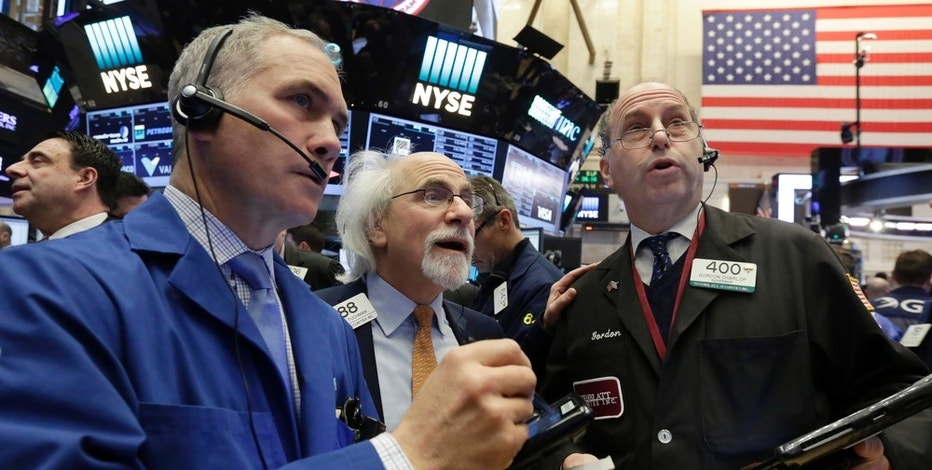Traders Timothy Nick, left, Peter Tuchman, center, and Gordon Charlop work on the floor of the New York Stock Exchange, Thursday, March 16, 2017. U.S. stock indexes took a small step back on Thursday, while bond yields recovered some of their sharp losses from the prior day. Stock markets around the world rallied. (AP Photo/Richard Drew)