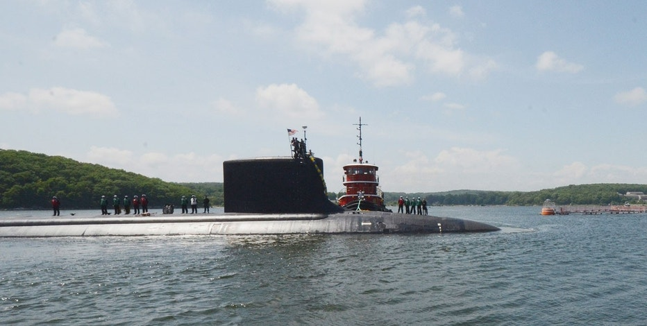 The attack submarine USS Virginia (SSN 774) returns to Submarine Base New London after completing a 14-week surge deployment.