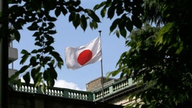 The Bank of Japan kept monetary policy steady, maintained upbeat view