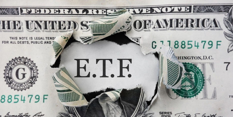 Torn dollar with ETF message, Exchange Traded Fund stock market concept