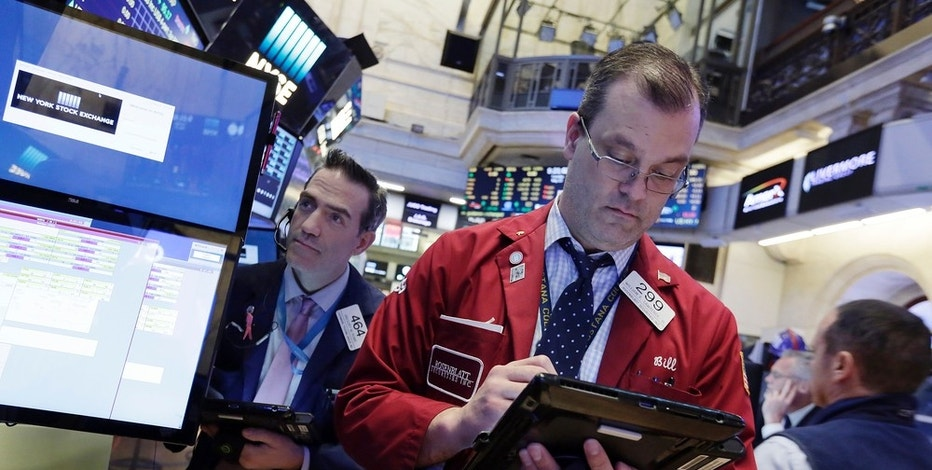Traders Gregory Rowe, left, and William Lawrence work on the floor of the New York Stock Exchange, Tuesday, May 23, 2017. Stocks are opening slightly higher on Wall Street as technology companies post more gains. (AP Photo/Richard Drew)