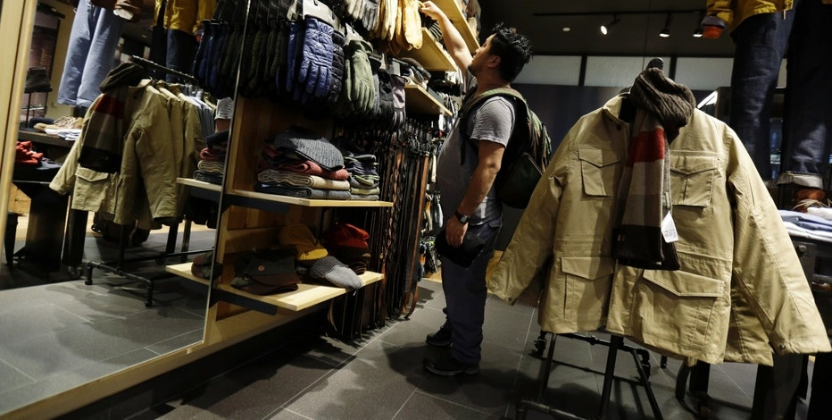 In this Friday, Oct. 4, 2013, photo, a shopper browses at a Timberland store in Skokie, Ill. The Conference Board releases the Consumer Confidence Index for October on Tuesday, Oct. 29, 2013. (AP Photo/Nam Y. Huh)