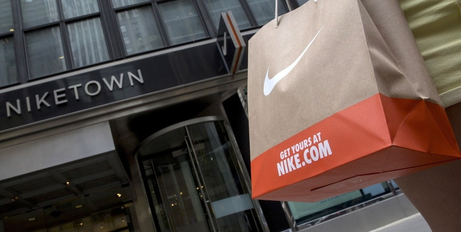 A customer exits the Niketown store in midtown Manhattan in New York June 25, 2015. Nike Inc, the world's largest footwear maker, reported a better-than-expected profit for the eighth quarter in a row as it sold more high margin basketball shoes and apparel at higher prices.  REUTERS/Brendan McDermid  - GF10000139307