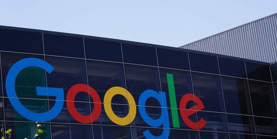 FILE - This Tuesday, July 19, 2016, file photo shows the Google logo at the company's headquarters in Mountain View, Calif. Google parent Alphabet is taking a $2.7 billion write-down to cover a large fine EU antitrust enforcers assessed in June 2017. While the search giant can shrug off the cost, uncertainty lingers over its ability to operate freely on the continent going forward. (AP Photo/Marcio Jose Sanchez, File)