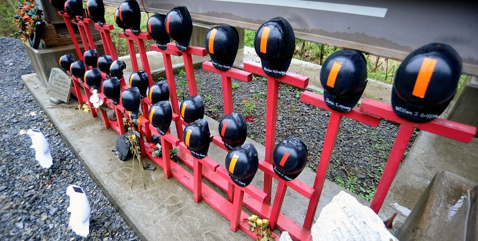 Helmets adorn a memorial made by local residents to honor the 29 West Virginian coal miners that lost their lives on April 5, 2010 in the Upper Big Branch mining disaster, on Route 3 near Whitesville, West Virginia April 13, 2015.