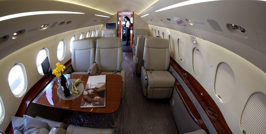 A crew member is seen inside Falcon 2000S jet during the Latin American Business Aviation Conference and Exhibition (LABACE) at Congonhas Airport in Sao Paulo, Brazil, August 11, 2015.