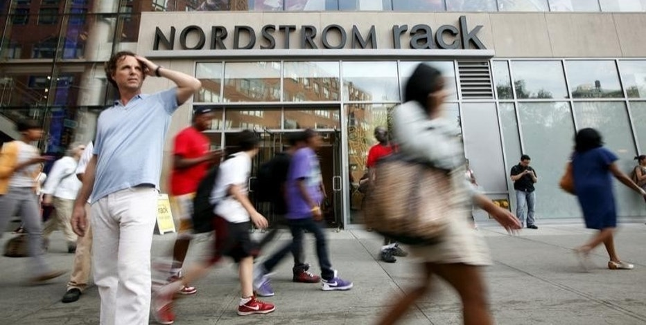 People walk past the Nordstrom Rack store, in New York's Union Square, May 21, 2010.    REUTERS/Chip East/File Photo