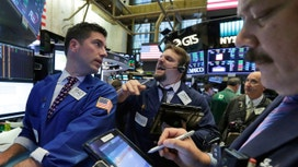 Wall St higher as bank stocks rebound, Apple gains