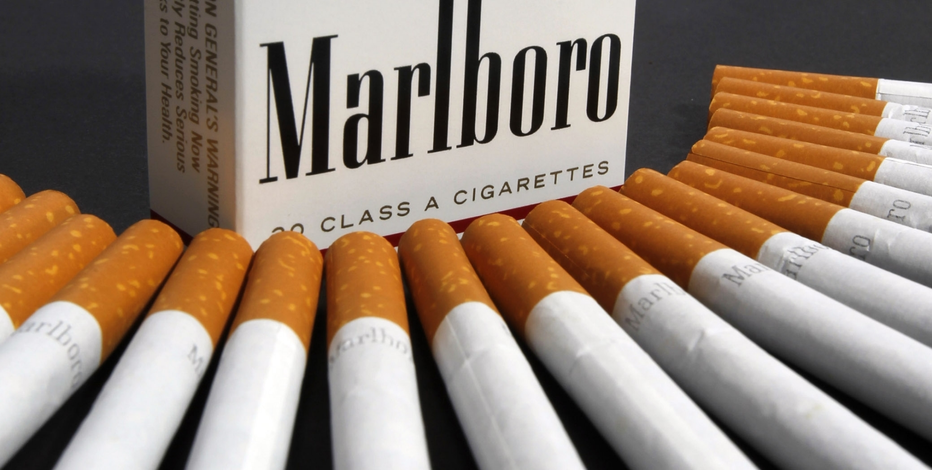 Philip Morris shares sink after earnings miss, revised guidance