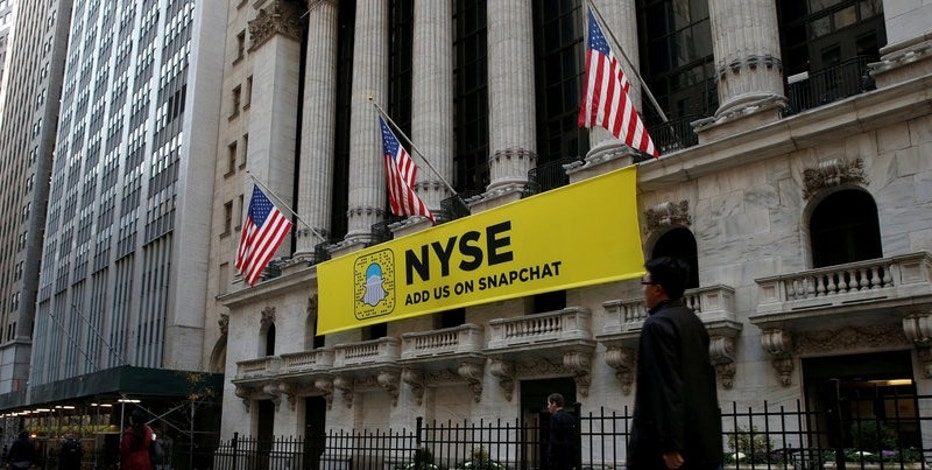 FILE PHOTO - The Snapchat logo is seen on a banner outside the New York Stock Exchange (NYSE) in New York City, U.S. on November 16, 2016.  REUTERS/Brendan McDermid/File Photo