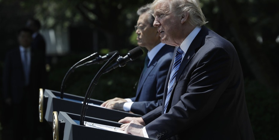 President Donald Trump, accompanied by South Korean President Moon Jae-in, speaks in the Rose Garden of the White House in Washington, Friday, June 30, 2017.