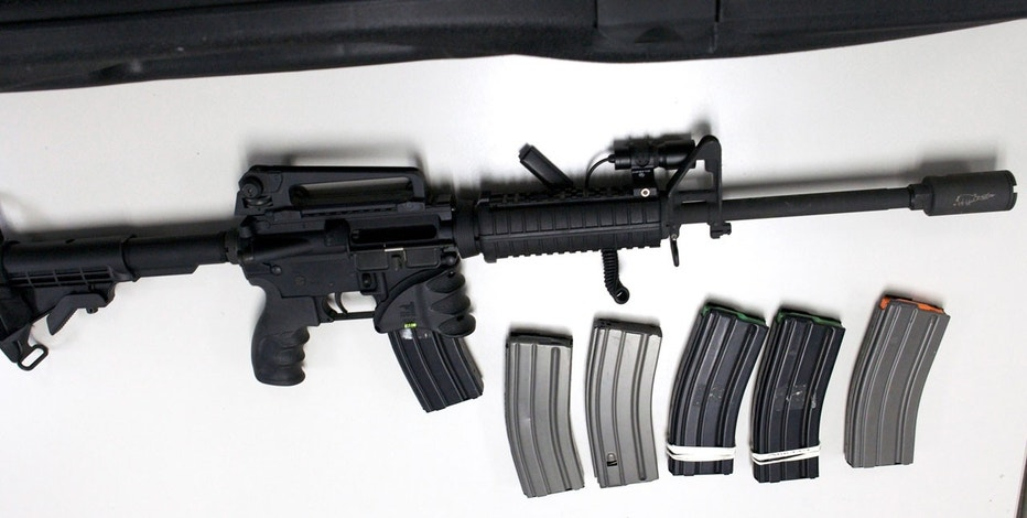 A Bushmaster semi-automatic assault rifle, similar to the type used by 20-year-old Adam Lanza during the shooting at Sandy Hook Elementary school on December 14, is turned in during a gun buyback event at the New Haven Police Academy in New Haven, Connecticut, December 22, 2012. The program, sponsored by the Injury Free Coalition for Kids of New Haven and Yale-New Haven Children's Hospital offered gift cards in exchange for working guns.