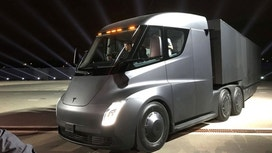 Tesla unveils electric big-rig truck in midst of Model 3 factory 'hell'