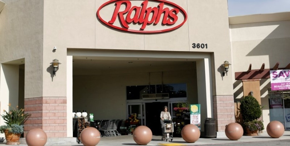 FILE PHOTO: A shopper walks out of a Ralphs grocery store, which is owned by Kroger Co, ahead of company results in Pasadena, California U.S., December 1, 2016.   REUTERS/Mario Anzuoni/File Photo