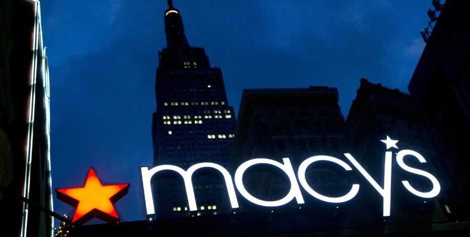 FILE - In this Nov. 21, 2013, file photo, with the Empire State building in the background, the Macy's logo is illuminated on the front of the department store in New York. A new year season is biting back at Macy's and Kohl's early in the new year, with the duo's shares tumbling in premarket trading on Thursday, Jan. 5, 2017, following news that they had trouble bringing shoppers into their stores to buy presents. (AP Photo/Mark Lennihan, File)