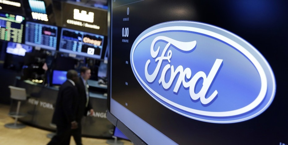 In this Tuesday, May 16, 2017, photo, the logo for the Ford Motor Company appears above a post on the floor of the New York Stock Exchange.