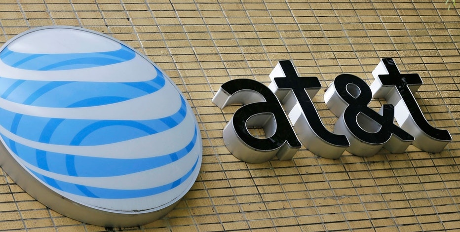 This Thursday, Oct. 12, 2017, photo shows an AT&T sign at a store in Miami. AT&T Inc. reports earnings Tuesday, Oct. 24, 2017.