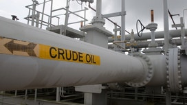 Oil prices dip on stronger dollar
