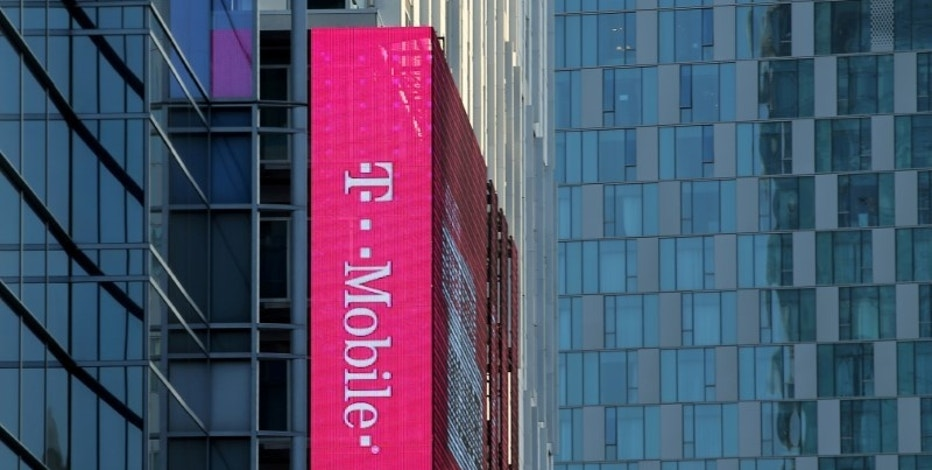 FILE PHOTO:    A T-Mobile logo is advertised on a building sign in Los Angeles, California, U.S., May 11, 2017. REUTERS/Mike Blake/File Photo