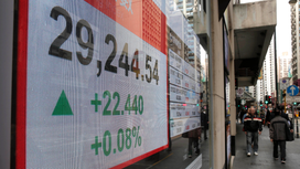 Asian shares mixed as Fed hike gives investors few surprises