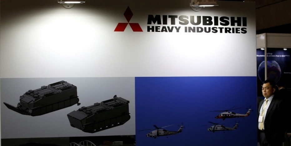 A visitor is seen at Mitsubishi Heavy Industries' booth during the Maritime Air Systems and Technologies Asia (MAST) show in Chiba, Japan June 12, 2017.   REUTERS/Toru Hanai