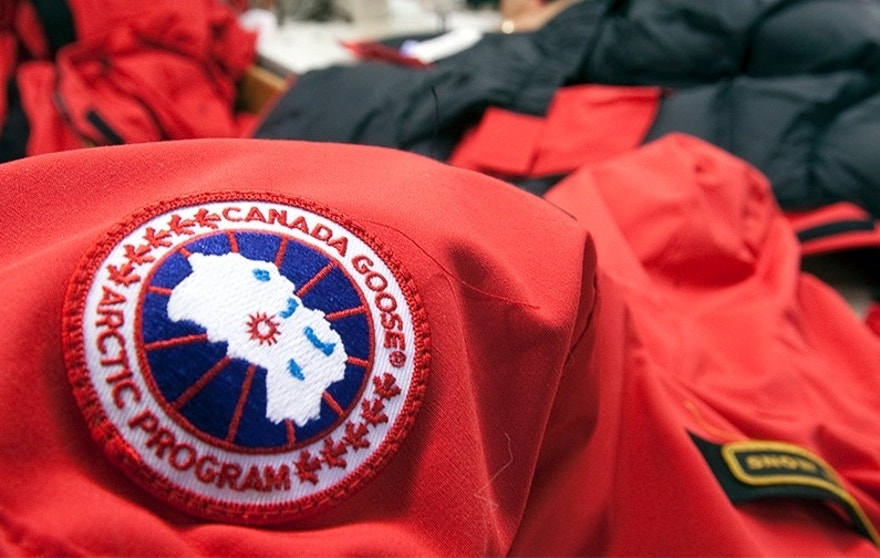 Workers piece together outerwear on the manufacturing floor of Canada Goose's facility in Toronto January 17, 2012. Coat maker Canada Goose found its niche by shunning the make-it-offshore phenomenon, producing its heavy duty down parkas on Canadian soil. Even as Canada's clothing industry crumbles, with employment down 60 percent  in just over a decade, the 55-year old family-run shop bucked the broader trend of moving production to low-cost locales by keeping manufacturing at home. Picture taken January 17. To match Analysis CANADA-NICHE/          REUTERS/Fred Thornhill  (CANADA - Tags: BUSINESS TEXTILE) - GM1E81S165U01