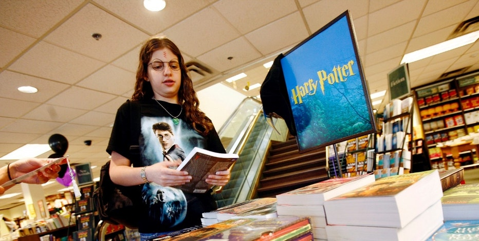 "Harry Potter fan Mallory Levy looks at Harry Potter novels at the Barnes & Noble bookstore before the midnight release of ""Harry Potter and the Deathly Hallows."""