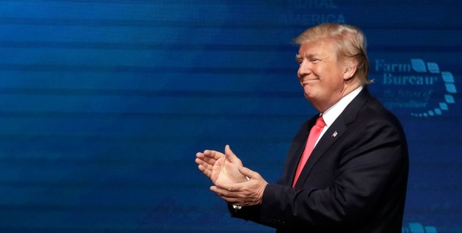 President Donald Trump applauds the crowd at the American Farm Bureau Federation annual convention Monday, Jan. 8, 2018, in Nashville, Tenn.