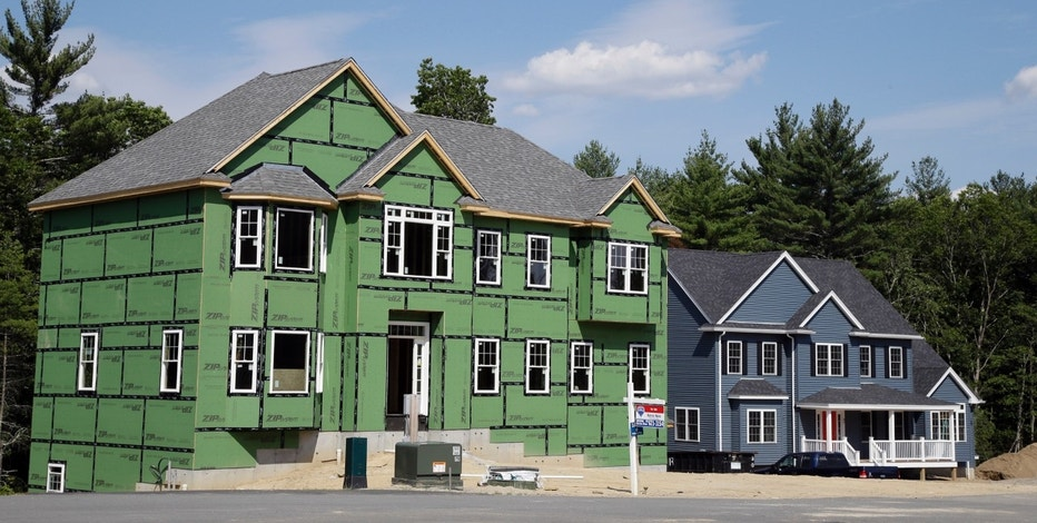 FILE - This Monday, July 10, 2017, file photo shows new housing construction, in North Andover, Mass. On Thursday, Dec. 28, 2017, Freddie Mac reports on the week's average U.S. mortgage rates. (AP Photo/Elise Amendola, File)