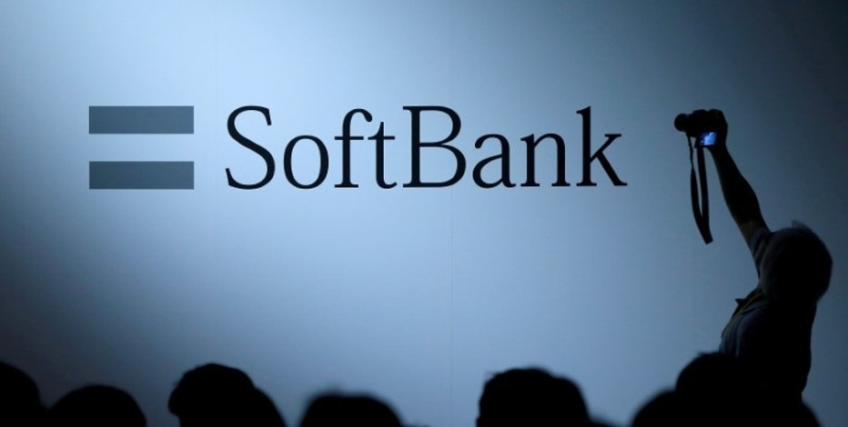 FILE PHOTO: The logo of SoftBank Group Corp is displayed at SoftBank World 2017 conference in Tokyo, Japan, July 20, 2017. REUTERS/Issei Kato/File Photo