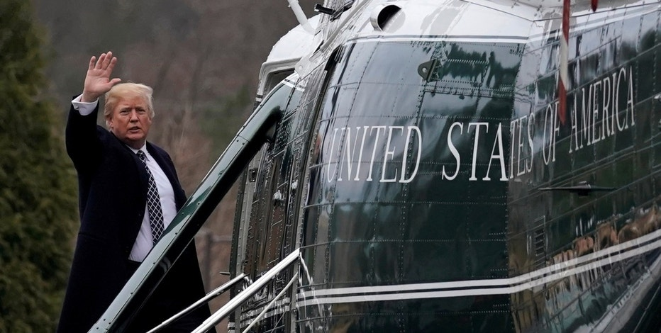 U.S. President Donald Trump waves from the steps of Marine One helicopter upon his departure after his annual physical exam at Walter Reed National Military Medical Center in Bethesda Maryland U.S