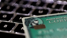 AmEx posts first loss in 26 years on tax charge, suspends buybacks